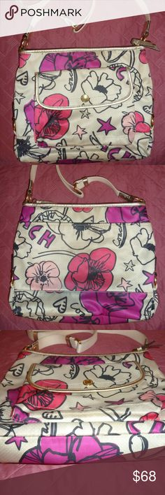 COACH Crossbody Purse, Kyra Floral, Nice Bag! COACH CROSSBODY BAG I believe the print is called 'Kyra'  Long strap is adjustable. Two outside pockets, one with a magnetic closure. Inside are 2 side pockets & 1 zippered. Purse closes at top via zipper. I think the golden trim is leather. Condition: No hang tag but otherwise, looks great! No rips/holes, or serious flaws.There are some signs of wear, mainly in the form of various markings on purse, none are severe. Some dirt/scuff marks. A…