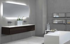 love these faucets!! easy water cleanup!  Lacquered wall-mounted vanity unit K.ONE | Double vanity unit K.One Collection by RIFRA | design Byoung Soo Zocchi