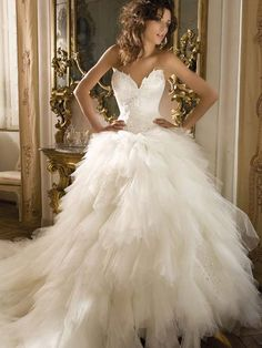 FABRIC: Demetrios B154 wedding dress. Tulle Ball Gown Strapless With Tiers Of Tulle And Beaded Appliques   Lol this dress is following me! I love the whispys on the top of the bodice