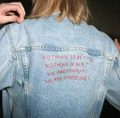 Nothing is better. Nothing is best.  We are unhappy. We are unblessed. Written in red on the back of a denim jacket