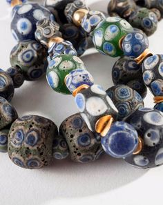 Two strands of ancient Phoenician glass beads.  45 & 46 cm long strands. Est. 1'200 - 1'800€ per strand.