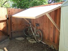 Fence Supported Bike Shelter Bike Shelter Outdoor Bike Storage Diy Bike Storage Shed Beginner Woodworking Project Outdoor Diy And Gardening Knowledge From A To Z Backyard Pergola Diy Backyard Bike Storage With An Easy To… Shed Storage, Diy Storage, Scooter Storage, Bike Storage Ideas Diy, Bike Storage Cover, Carport With Storage, Bike Cover, Backyard Storage, Kayak Storage