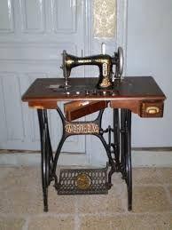 Resultado de imagen para como se coloca la correa una maquina de coser aiko