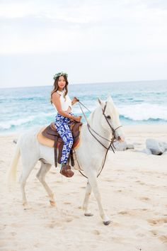 white crop top, tie dye pants and floral crown- horseback riding in cabo http://www.songofstyle.com/