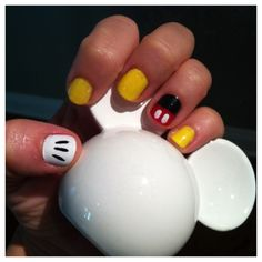 How to Get A Disney World Inspired Manicure: Photos, Instructions, and lots of Disney Nail Art. (article)