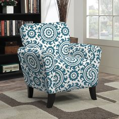 The Portfolio Home Furnishings Sasha chair features upholstery in a contemporary Caribbean blue and cream medallion pattern. The chair features a transitional design with flared arms and shaped back for style and comfort.