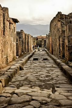 """Ruins of Pompeii, Italy. In """"On Distant Shores"""" Lt. Georgie Taylor visits Pompeii in 1944, using these stepping stones to cross the street."""