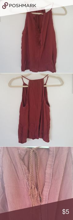 $5 boho summer top This boho top is very light weight and breezy. The are no stains either. The center has a clasps so you have pick how far it goes up or how much is revealed also this string can be undone to your liking. The color is also a rusty red. This comes washes but for your future washing hand wash it or the tasles will get all messes up. La Hearts Tops