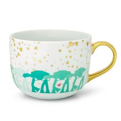 white jumbo latte mug has AT-ATs in shades of mint stomping around the bottom under a sky that's snowing gold hearts. Star Wars!