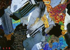 Thin section of gabbro with twinned plagioclases and exsolution lamellae of two pyroxenes.