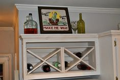 I built me a wine rack, yall!     Our kitchen has been undergoing alot of character building lately. What was an outdated, blank-slate ki...