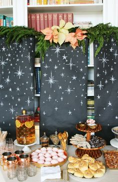 you can use the black kraft paper, draw the stars on a chalkboard that you have or use the table runner from target