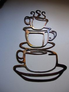 Stacked coffee cups decor with an aged copper finish. Perfect for every kitchen!