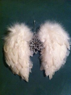 DIY Angel wings Christmas ornament.- use up some of the donated costume jewelry?