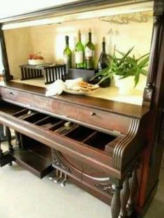 Upright piano converted to a home bar.