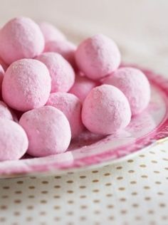 Truffles dusted in pink.