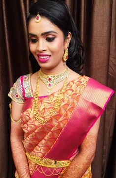 Traditional Southern Indian bride wearing bridal silk saree and jewellery. Reception look. Makeup and hairstyle by Swank Studio. #BridalSareeBlouse #SariBlouseDesign   Find us at https://www.facebook.com/SwankStudioBangalore
