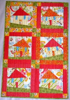 Up for bid: Handmade Wonky Houses Quilt. All auction proceeds go to provide critical surgeries for orphaned children in China. Love Without Boundaries is a registered 501(c)(3) organization in the U.S.