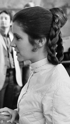 hanandleiaxx:  Carrie fisher enjoying some soda during a break on set of esb, let's take some time to appreciate her hair do