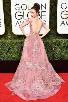 2017 Golden Globes: Nominee Lily Collins in Zuhair Murad couture is a fairytale. If there was ever a tule look that rivaled that of the iconic Carrie Bradshaw tutu moment, it's this one. And if you caught Collins' moment during the red carpet, you know it was the first gown she tried on.