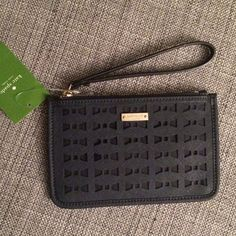 "Kate Spade Cedar Street Perforated Bee - Off Shore From web: Slender wristlet featuring gold-tone logo plaque and crosshatch overlay in die-cut bow pattern. 100% Leather. Fabric lining. Zipper closure. 5"" wristlet handle drop. 4.25"" high, 6.5"" wide. kate spade Bags Clutches & Wristlets"