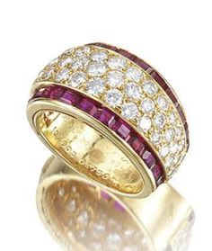 A diamond and ruby ring, by Van Cleef & Arpels Pavé-set with brilliant-cut diamonds, boarded to each side by channel-set calibré-cut rubies, mounted in 18k gold, diamonds approximately 1.50 carats total, signed Van Cleef & Arpels
