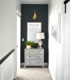 Looking to freshen up a space with some bold color, but feeling a bit nervous about going bold? Exhibit A: End of the hallway, ho hum wall. Exhibit B: End of the hallway, Stunning wall! Introducing, just grab and go p Hallway Wall Colors, Hallway Paint, Hallway Walls, Upstairs Hallway, Blue Hallway, Upstairs Landing, Hallway Furniture, Navy Accent Walls, Navy Blue Walls