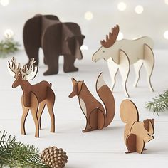 Laser-cut wood pieces assemble into 3-dimensional, freestanding animals for individual display or as part of woodland scene with other objects in the laser-cut wood collection. Pieces slide apart and stack for flat storage in a reusable box.