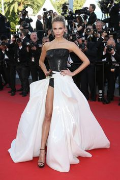 Model Natasha Poly wears an Atelier Versace gown from the F/W '14 collection
