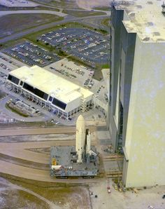 This aerial view of STS-1 shows the space vehicle for the first Space Shuttle mission shortly after it was moved out of the Vehicle Assembly Building.