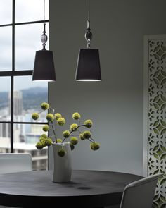 Tech Lighting's Kiev is a twist of antique and modern style.  It is defined by its turned ornate glass fount and gracefully tapered fabric shade.  This piece's antique charm adds a unique element to any space.  It is available in black, brown, and white color options.  The fount is offered in clear, frost, or smoke color options.  www.luxurylightingdirect.com
