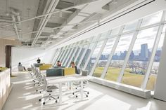 WRNS Studio completed the Two Sigma Collision Lab offices, an accelerator for this systematic investment manager located at Cornell Tech in New York City, City Office, Open Office, Office Spaces, Acoustic Ceiling Tiles, Roosevelt Island, Cafe Seating, Innovation Centre, Workplace Design, Open Layout