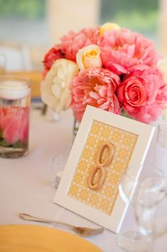 Roses and peonies in hues of pink and white get a sweet boost from bright yellow place settings.