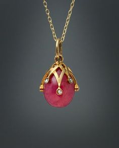 Antique Russian Koehli Egg Pendant Made in St. Petersburg between 1904 and 1908 by jeweler of the Imperial Court and competitor of Faberge - Frederic Koehly (Friedrich Koehli). Koehli's jewelry is easily recognizable by the bold three dimensional designs. His jewelry is rare, especially egg pendants. A carved rhodonite egg is applied with gold interlaced triangular swags accented by rose cut diamonds. The pendant is marked on the suspension ring with 56 zolotnik old Russian gold standard…