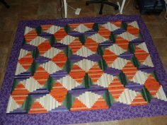 Carrot Sticks Log Cabin Quilt. All those strips of various oranges remind me of peeling carrots!