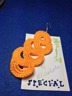 Long fashion crocheted earrings. Dimension: 8 cm (3.15) length x 4 cm (1.57) width. Material: microfiber + metallic thread and metal ear wire.