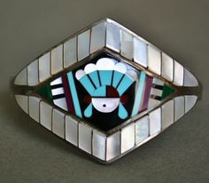 Zuni sunface inlay cuff, with mother of pearl, turquoise, jet and coral