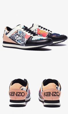 Trendy Womens Sneakers : The zebra print design and warm color pop make for the perfect dress-up sneaker