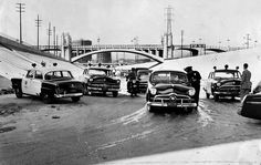 1955 Drag Racing Bust (LA Times), Police check licenses on hopped-up cars driven by teen-agers drag racing on paved section of the Los Angeles River bottom. Four squad cars converged on racers. Photo taken at Street Bridge. Sheriff, California History, Southern California, Lakewood California, California Style, Los Angeles Police Department, Ford, Police Cars, Police Vehicles