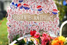 """The grave of women's suffrage leader Susan B. Anthony is covered with """"I Voted"""" stickers left by women voters in the U.S. presidential election, at Mount Hope Cemetery in Rochester, New York, on Nov. 8."""