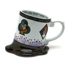 This kooky Alice In Wonderland mug is designed to look like it's melting! The ceramic design is finished with artwork of Alice, the Cheshire Cat and other favourite characters.
