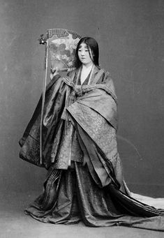 Portrait of Woman with Face Makeup and in Costume of Fujiwara Period and Holding Fan.