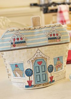 Retro Cottage Tea Cosy, designed by Alison Poole, from @CrossStitcher, via Anchor/Coats.