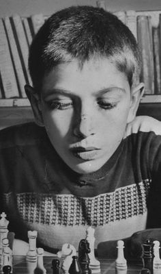 Bobby Fischer, two months shy of turning 15 years old, becomes the youngest U. chess champion in The Sporting Life, Art Through The Ages, Chess Players, New York Daily News, Chess Pieces, Sports Stars, Best Player, High School Students, World Championship