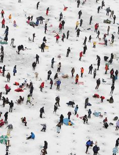Anglers cast lines through holes into a frozen river during an ice fishing competition at the Hwacheon Sancheoneo Ice Festival on January 5, 2013 in Hwacheon-gun, South Korea. The annual event attracts thousands of visitors and features a mountain trout ice fishing competition in which participants compete with tradition lures or with bare hands. (Chung Sung-Jun/Getty Images)
