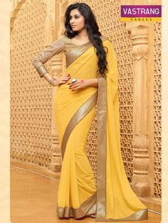 yellow georgette saree with golden blouse
