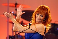 Reba McEntire  Worth more than $65 million, the funny, lovable red-headed singer and actress is one of the wealthiest country stars around. Her career includes seven Academy of Country Music top female vocalist awards, 12 American Music Awards and she's sold more than 80 million albums.