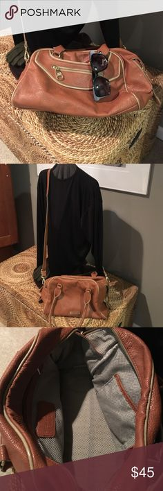 "👜Steve Madden Satchel or cross body 💼 12X9""X6"". Very nice and clean inside and outside. Nice gold tone hardware. No issues at all excellent condition. Color saddle brown with lighter tan trim .. several compartments. At least 5 different compartments. Steve Madden Bags Crossbody Bags"