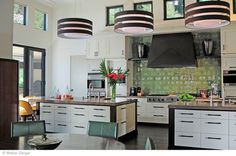 The colored backsplash done by @walkerzanger brings the unexpected to this kitchen.