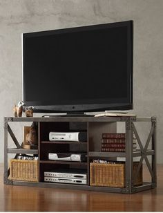 Bring an industrial edge to your loft-inspired decor theme with this Signal Hills media stand. Featuring a metal frame and vintage-looking wood accents, this piece offers a striking mix of antique and